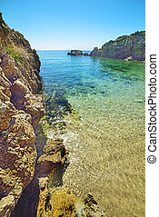 rocky shore and crystal clear water