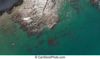 Rocky shore by the sea. Aerial shot - Spans along the bay...
