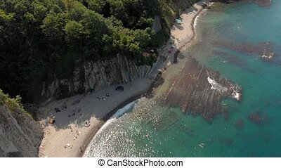 Rocky shore by the sea. Aerial shot - Spans along the rocky...