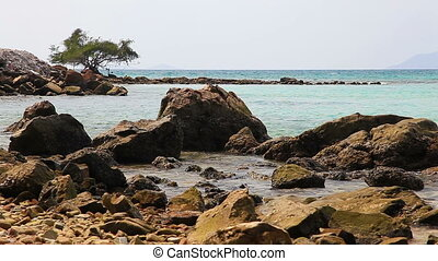 Rocky Shore - Rocky wild beach of Thailand on a cloudy day