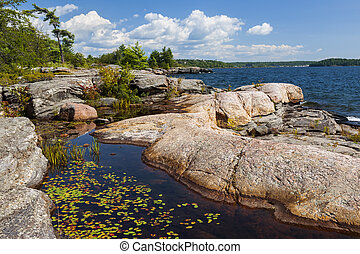 Rocky shore in Georgian Bay - Rock formations at rocky lake...