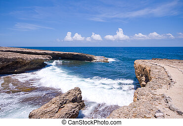 rocky shore inlet - tropical shore inlet with nice waves