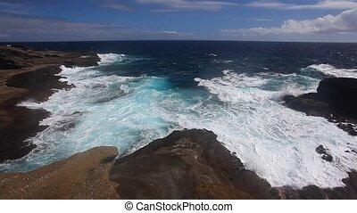 Rocky Shore  - Ocean waves crash over a rocky shore.