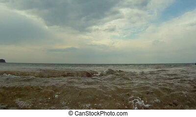 Rocky shore - Ocean waves rolling along the rocky shore.