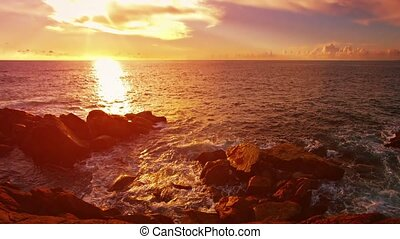 Rocky shore of a tropical beach before sunset