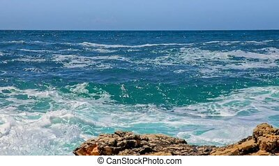 Rocky shore of the Adriatic sea after storm slow motion from...