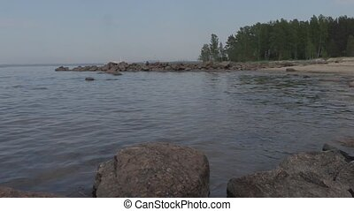 rocky shore of the gulf of finland summer day.