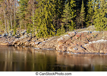 rocky shore of the river