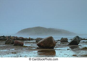 Rocky shore in rainy weather