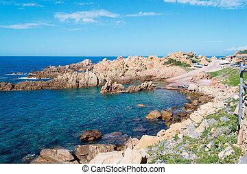 rocky shore - costa paradiso rocky shore on a clear day