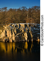 Rocky shore of a small lake in winter setting (Sweden)