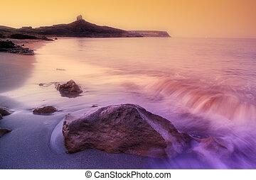 rocky shore - sunrise on a rocky shore in Sardinia, Italy