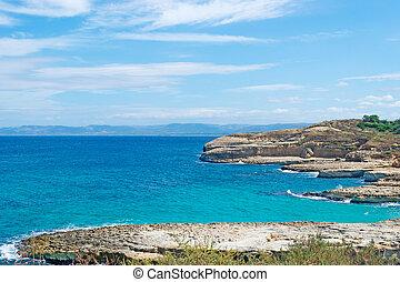 rocky shoreline in Porto Torres, Sardinia