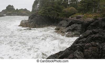 Rocky shoreline. Stormy ocean.