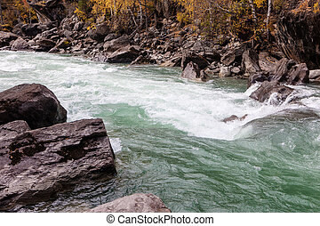 rocky shores of mountain river
