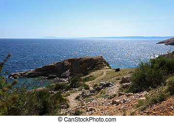 Rocky summer bay shore in the Adriatic sea, Croatia. View from the hill