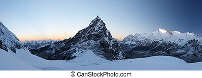 Panoramic image of sunrise over Kanchung mountain 6103m with Cho Oyu 8201m in background . Everest region, Himalayas, Nepal.