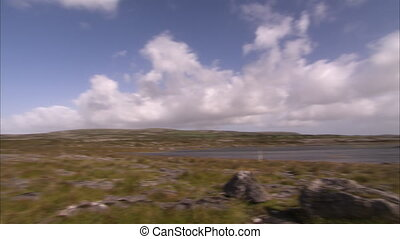 Rocky terrain Ireland landscape - A pan to right shot of a...