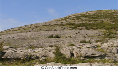Rocky terrain uphill - A pan to right shot of a rocky...