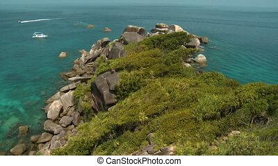Rocky, Tree-Filled Peninsula - Handheld, tilting, wide shot...