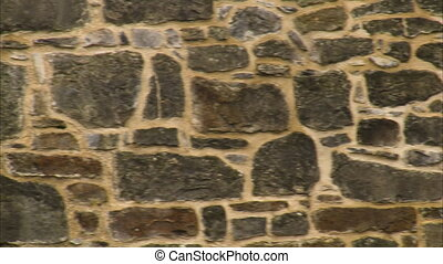 Rocky wall of a castle - A pan to left medium shot of a...