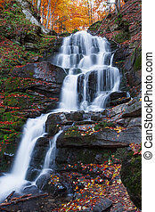 rocky Waterfall in Autumn forest