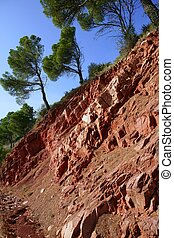 Rodeno red stone mountain side with pine trees
