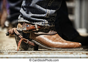Rodeo Cowboy Boot and Spur - Close up of a rodeo cowboy's...