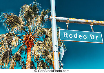 Rodeo Drive Road Sign on fashionable street Rodeo Drive in Hollywood.