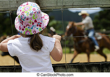 Rodeo - Little girl watch rodeo show.