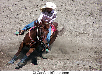A woman on a horse competing in a rodeo event