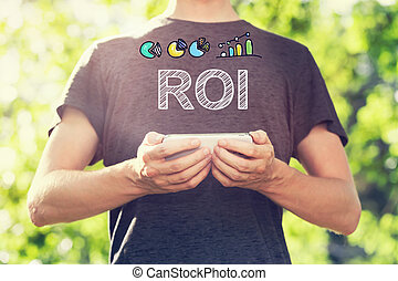 ROI concept with young man holding his smartphone
