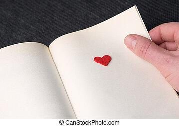 rojo, decorativo, corazón, en, un, libro, página