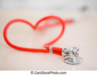 rojo, médico, estetoscopio, en forma, de, corazón, en, tabla