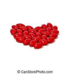 rojo, píldoras, medicina, forma corazón, blanco, plano de fondo