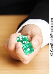 Roll a dice - A businessman rolling a dice
