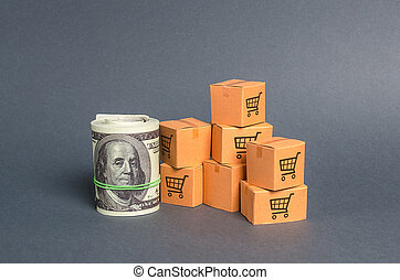 Roll bundle of dollars and cardboard boxes. International ...