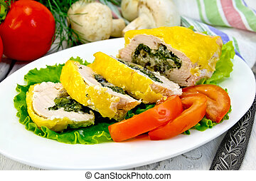 Roll chicken with mushrooms on salad in plate