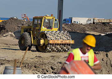 Roll compactor at construction site - Rusty roll compactor ...