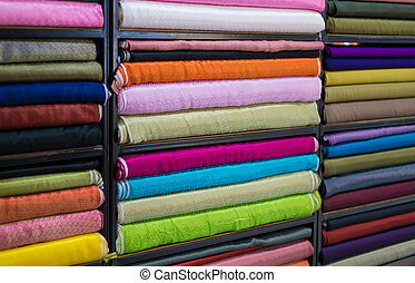 Roll in a colorful satin fabric store. Satin with a satin...
