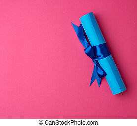 roll of blue paper tied with a silk blue ribbon