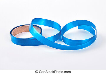 Roll of blue ribbon on white background.