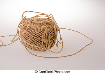 Roll of brown color linen string on white background