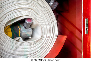 Roll of canvas hose in the emergency firefighting box