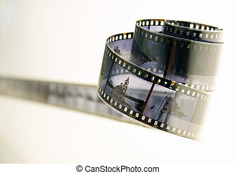 roll of developted slide film with photos of architercure monumets on white background