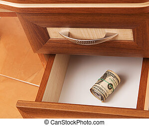 roll of dollars in open desk drawer