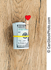 Roll of dollars with yellow rubber