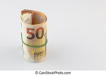 Roll of fifty euro banknotes with a rubber band, isolated background