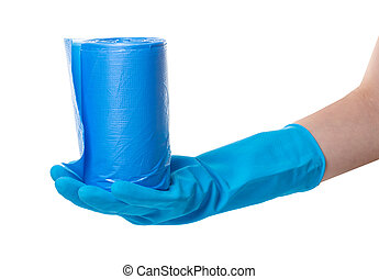 roll of garbage bags in a hand