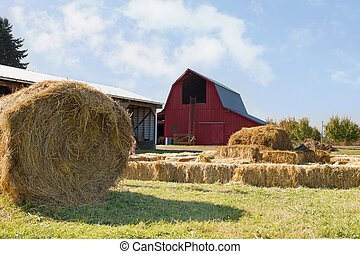 Roll of Hay by the Red Barn